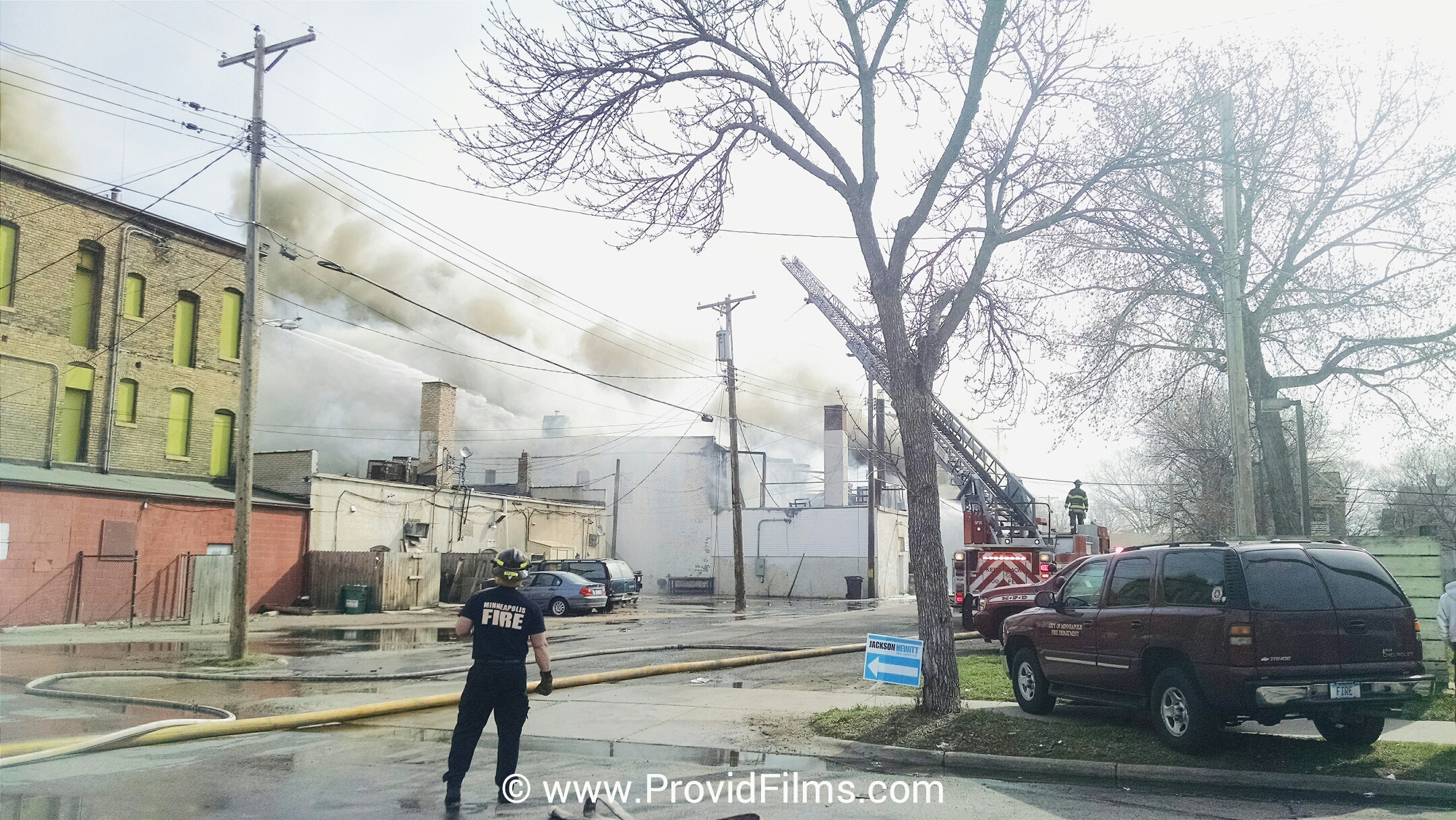 Firefighters battling the W Broadway Minneapolis Fire April 15th 2015